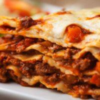14546335 - italian lasagna on a square plate